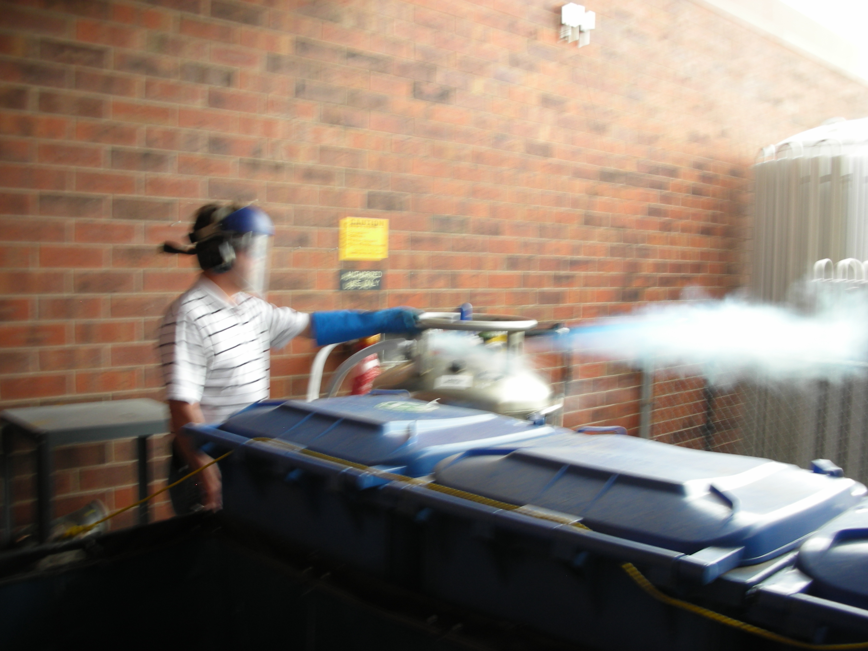 Filling a dewar with liquid nitrogen.